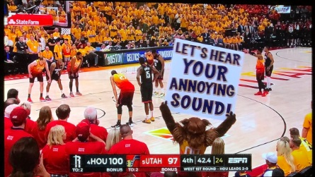 PHOTO Jazz Mascot Holds Up Sign That Says Let's Hear Your Annoying Sound