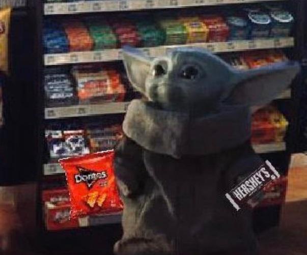 PHOTO Baby Yoda Getting Doritos And Hershey's Chocolate Bar At The Gas Station