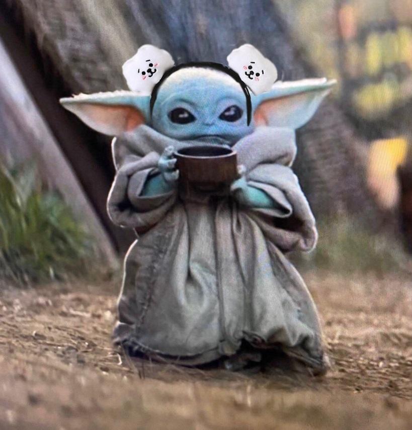 PHOTO Bald Baby Yoda With Ear Muffs