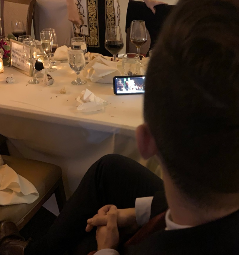 PHOTO Dude Watching McGregor Fight On His Phone During His Family Members Wedding