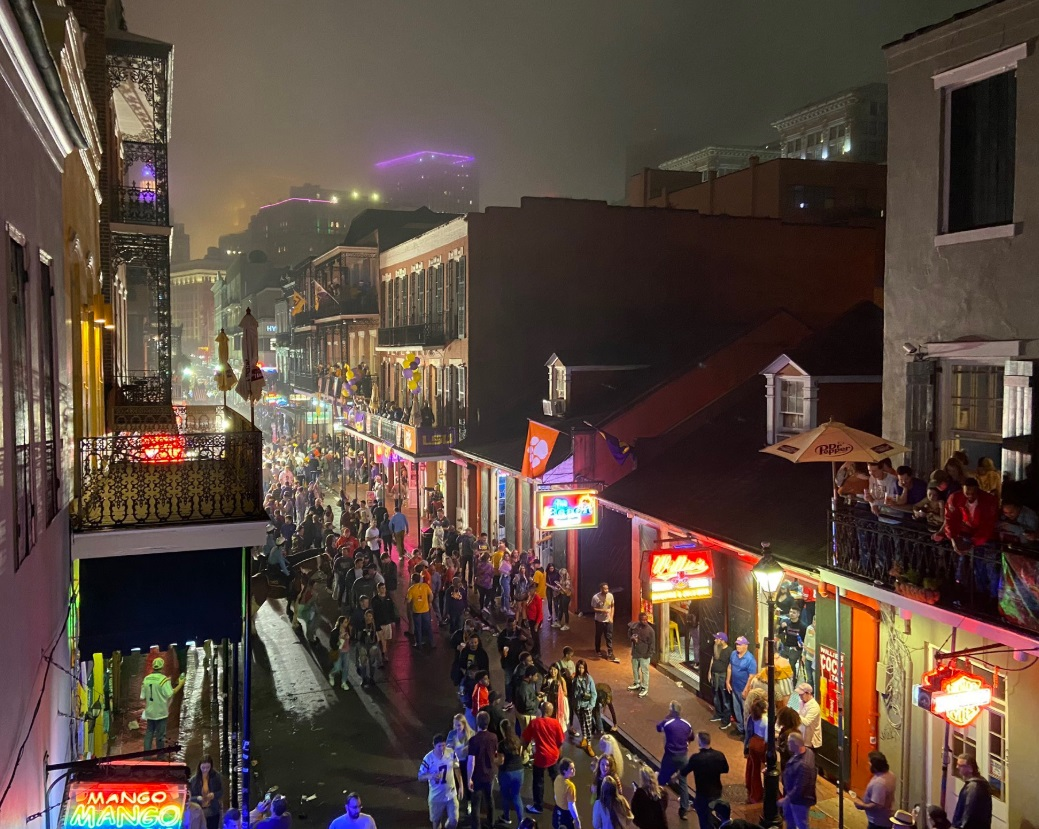 PHOTO Unbelievable Sight On Bourbon Street Building In Background Lit Up Purple LSU Fans Flooded The Streets After National Title Win