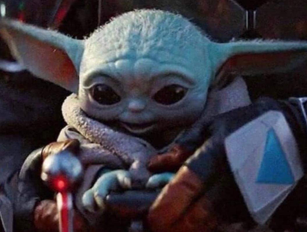 PHOTO Baby Yoda Delighted Using A Videogame Controller