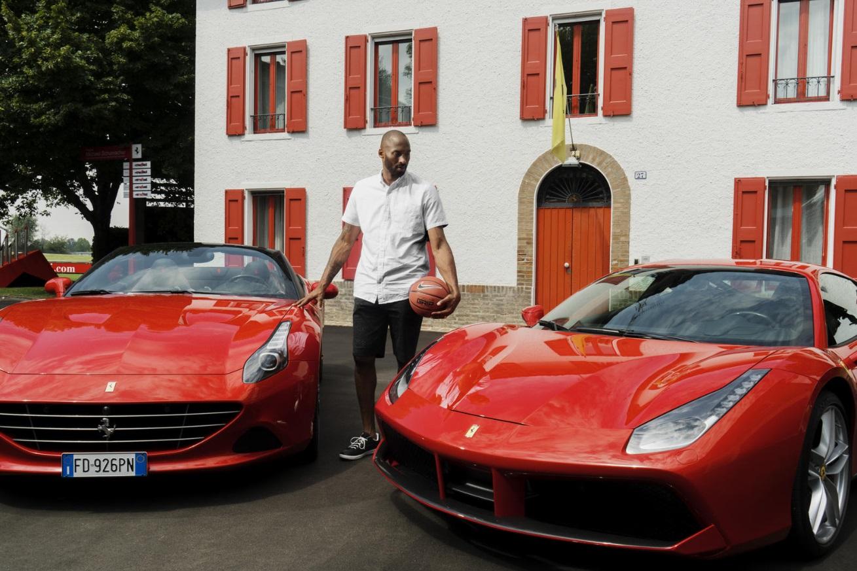 PHOTO Kobe Bryant Standing Between Two Ferrari's